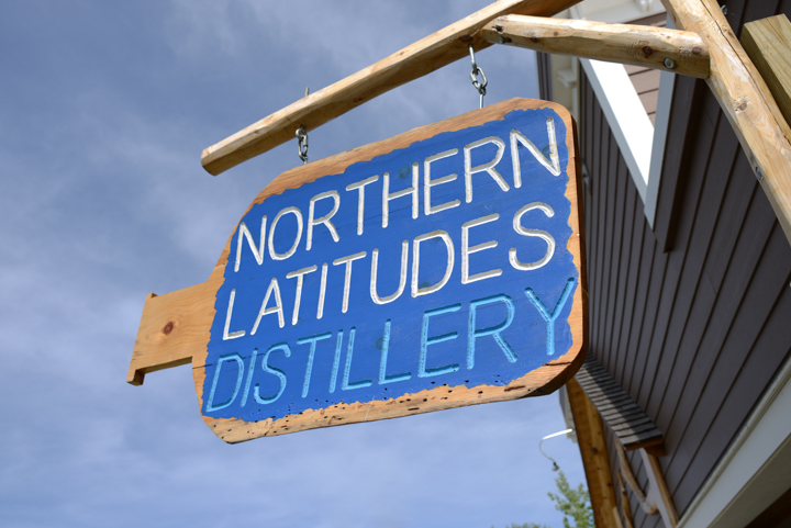 The sign greeting you at Northern Latitudes Distillery.